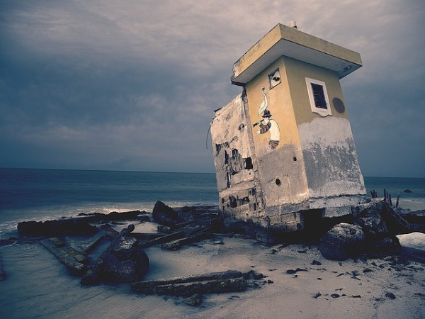 Image of broken building by the sea